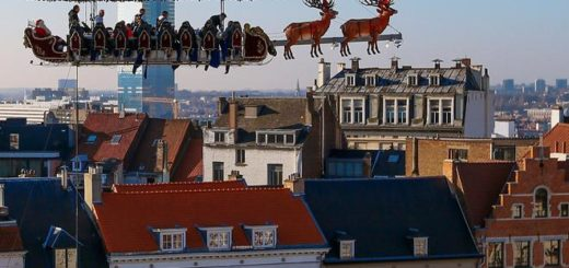 """Guests enjoy a dinner at the table """"Santa in the sky"""" lifted by a crane and elevated at 50 meters in the air and decorated to match the appearance of a """"Santa Sleigh"""", as part as the Christmas festivities in Brussels, Belgium, November 25, 2016. Picture taken November 25, 2016.  REUTERS/Yves Herman TPX IMAGES OF THE DAY"""