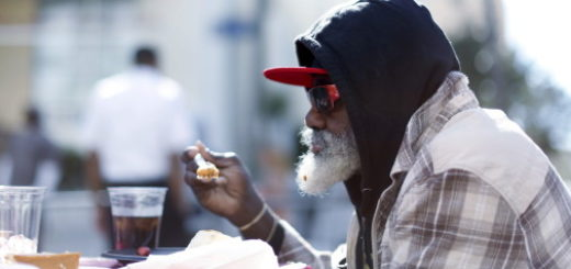 A man eats an early Thanksgiving meal served to the homeless at the Los Angeles Mission in Los Angeles