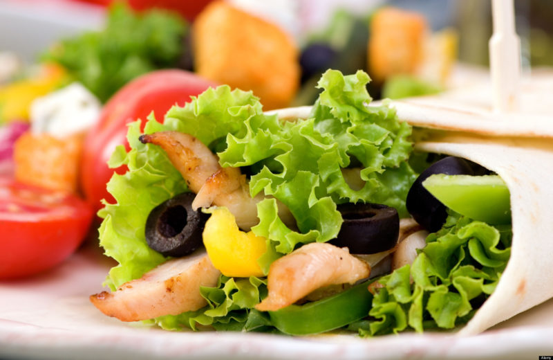 AF9GCY A appetizing chicken wrap with lots of vegetables and a side salad