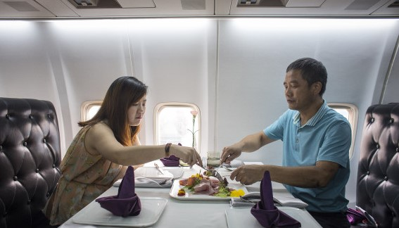"""WUHAN, CHINA - SEPTEMBER 09: Customers eat lunch in airplane restaurant on September 9, 2016 in Wuhan, Hubei province, China.. Different from the past airplane theme restaurants, this international route cuisine restaurant named """" jasmine aviation"""" is transformed from a retired Boeing 737 aircraft, and is the first airplane restaurant in the country. The operator of this restaurant Lilang claims that the retired aircraft was bought from the Batavia Airway of Indonesia, and it took almost 4 months in transporting and took 35 million Yuan. (Photo by Wang HE/Getty Images)"""